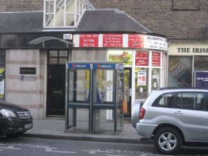 Locksmith Office with two phone booths in front of it